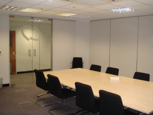 We can help you change the used of your mezzanine to house a modern new meeting room