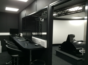 Hitech GP's new simulator room as seen via the control room viewing window and door.