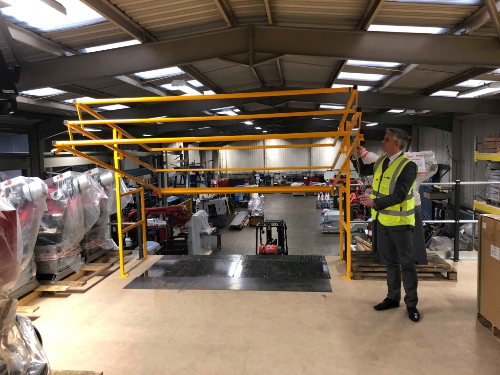 With a firm pulling down motion the up and over pallet gate moves into position, ready to receive pallets.