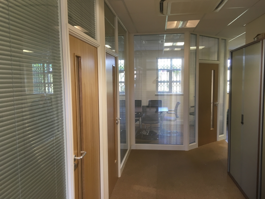 glass offices and meeting room with double glazed partitioning and blinds