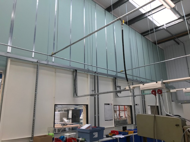 inside the workshop showing the existing steel partitioning and shaftwall extending up to the ceiling