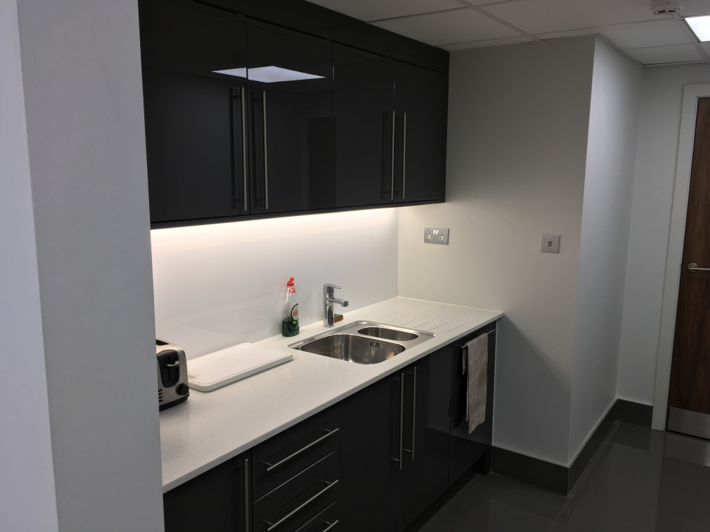 Refurbished kitchen area - installed by Cubex Contracts and with bespoke cabinet doors manufactured by the customer