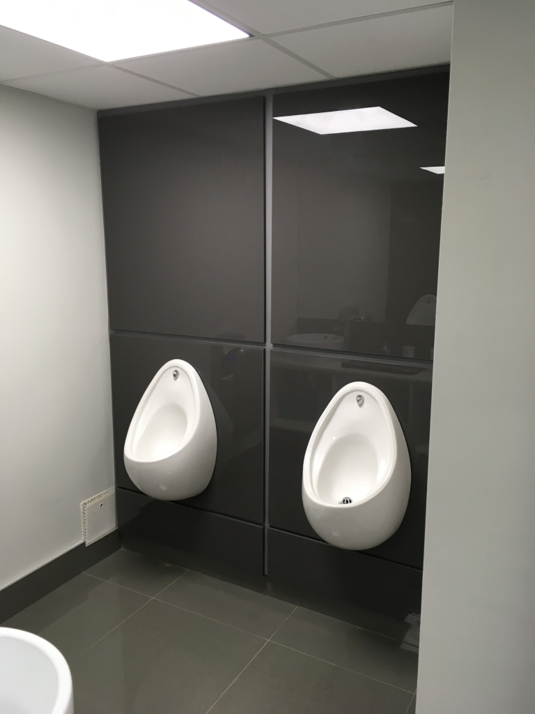 Refurbished urinals gents with high spec cubicles manufactured by the customer